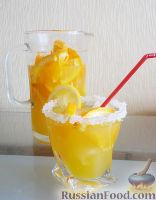 Фото к рецепту: Апельсиновый лимонад / Безалкогольный крюшон