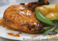 Фото к рецепту: Куриное филе, запеченное под цитрусовым соусом