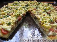 Фото к рецепту: Пицца с ветчиной, томатами и яйцом