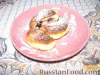 Фото к рецепту: Сырники с черникой