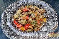 Фото к рецепту: Пельмени, запеченные с овощами
