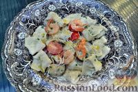 Фото к рецепту: Тортеллини с лососем в сырном соусе