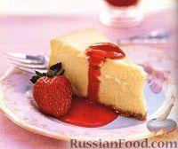 Фото к рецепту: Чизкейк с клубничным соусом