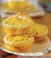 Фото к рецепту: Слоеные корзинки с сыром