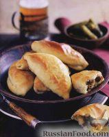 Фото к рецепту: Печеные пирожки с мясом