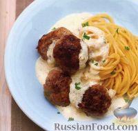 Фото к рецепту: Тефтели с белым соусом и спагетти