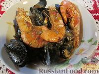 Фото к рецепту: Мидии и креветки в соусе Бузара