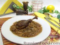 Фото к рецепту: Утка, тушенная с капустой
