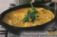 Фото к рецепту: Рыба в кокосовом соусе на пару