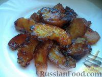 Фото приготовления рецепта: Яблочные дольки в карамели - шаг №12