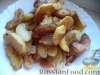 Фото приготовления рецепта: Яблочные дольки в карамели - шаг №9