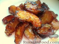 Фото к рецепту: Яблочные дольки в карамели