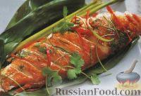 Фото к рецепту: Морской окунь в банановом листе, приготовленный на пару