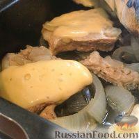 Фото к рецепту: Нежная свинина, запеченная с сыром