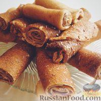 Фото к рецепту: Блинные рулеты с шоколадной пастой