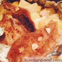 Фото к рецепту: Мясо с картофелем в фольге