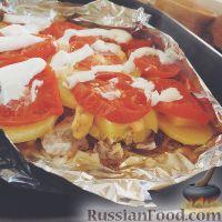Фото к рецепту: Мясо с картофелем и помидорами