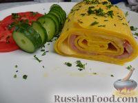 Фото приготовления рецепта: Рулет из яиц с начинкой - шаг №7