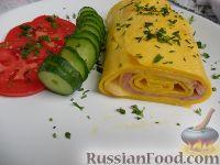 Фото к рецепту: Рулет из яиц с начинкой