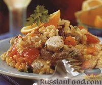 Фото к рецепту: Паэлья с птицей и фасолью
