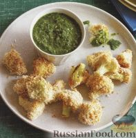 Фото к рецепту: Цветная капуста в панировке, запеченная в духовке