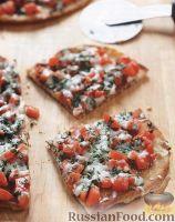 Фото к рецепту: Пицца с помидорами на сковороде