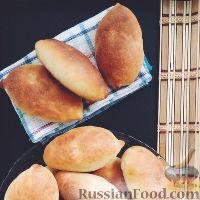 Фото к рецепту: Пирожки с квашеной капустой