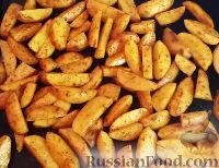 Фото приготовления рецепта: Картошка по-деревенски в духовке - шаг №4