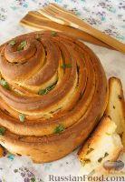 Фото к рецепту: Хлеб с чесночным маслом