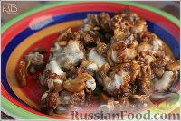 Фото к рецепту: Жареные шампиньоны с фаршем