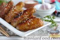 Фото к рецепту: Глазированные куриные крылышки по-азиатски