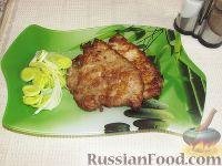 Фото к рецепту: Свиные отбивные в соевом соусе с чесноком