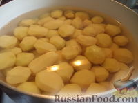 Фото приготовления рецепта: Картофель тушеный с мясом - шаг №7