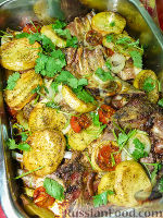 Фото к рецепту: Ребрышки с картофелем и помидорами