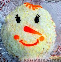 """Фото к рецепту: Рыбный салат """"Снеговик"""""""