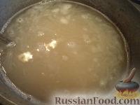 Фото приготовления рецепта: Каша пшеничная с маслом - шаг №4
