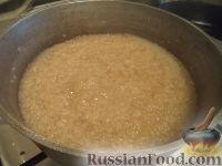 Фото приготовления рецепта: Каша пшеничная с маслом - шаг №5