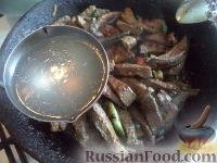 Фото приготовления рецепта: Поджарка из говяжьей печени - шаг №8
