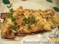 Фото к рецепту: Скумбрия запеченная, фаршированная картофелем