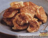 Фото к рецепту: Картофельные оладьи с сыром