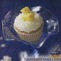 Фото к рецепту: Кокосовые маффины с ананасом