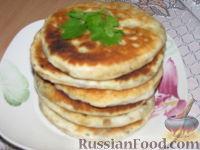 Фото к рецепту: Дрожжевые лепёшки с овощами и зеленью