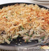 Фото к рецепту: Макароны, запеченные с грибами, тунцом и сыром на сковороде