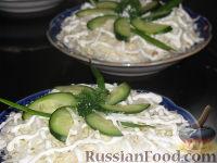 Фото к рецепту: Салат с капустой и шпротами
