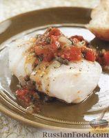 Фото к рецепту: Филе трески, приготовленное в томатном соусе