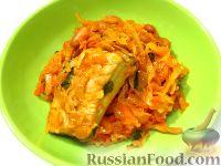 Фото к рецепту: Капуста, тушенная с ребрышками и фасолью