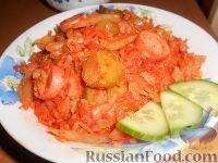 Фото к рецепту: Солянка из свежей капусты с рисом и сосисками