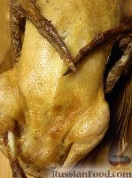 Фото к рецепту: Утка, фаршированная яблоками