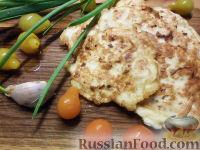 Фото к рецепту: Куриные отбивные в сырном кляре