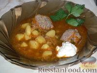 Фото к рецепту: Щи из квашеной капусты с фрикадельками